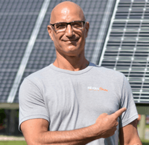 Greg Raffa Next to Solar Trackers